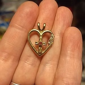 Gold colored cross pendant
